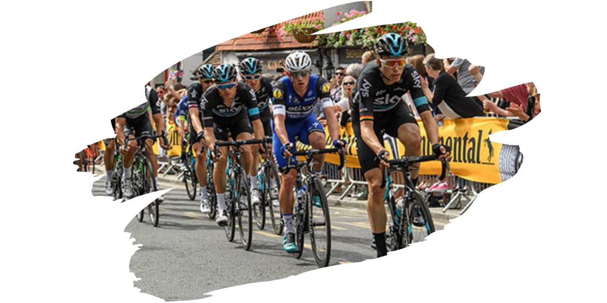 Groups of cyclists riding